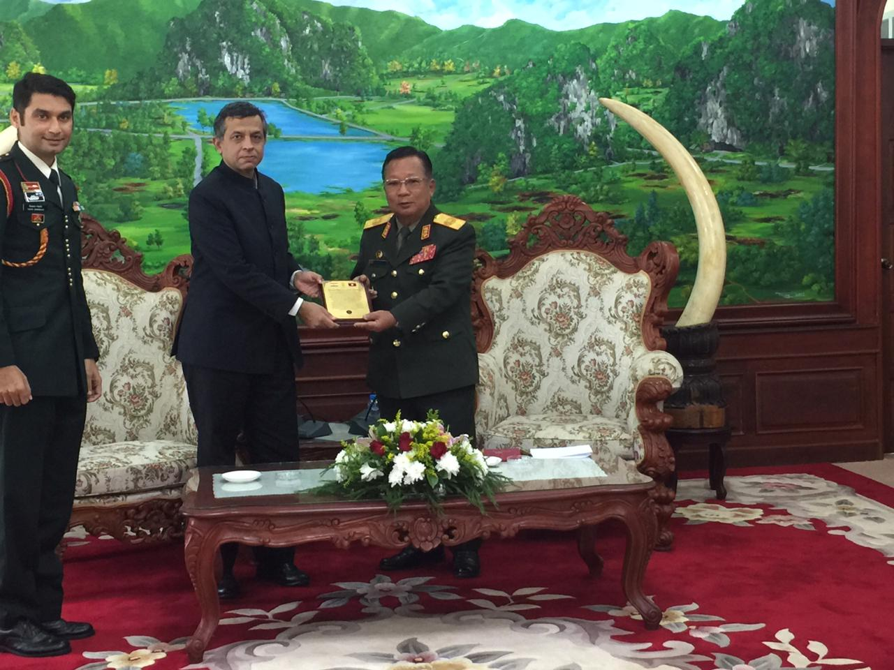H.E. Mr. Dinkar Asthana, Ambassador of India presents a memento and a journal to H.E. Mr. Chansamone Chanyalath, Hon. Minister of National Defence of Lao PDR, to commemmorate the silver jubilee (25 years) of the Indian Army Training Team in Lao PDR.
